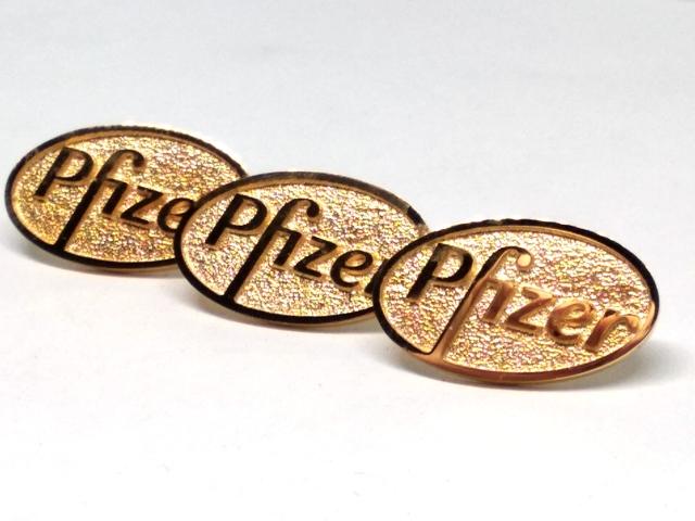 Значок из золота для компании Pfizer