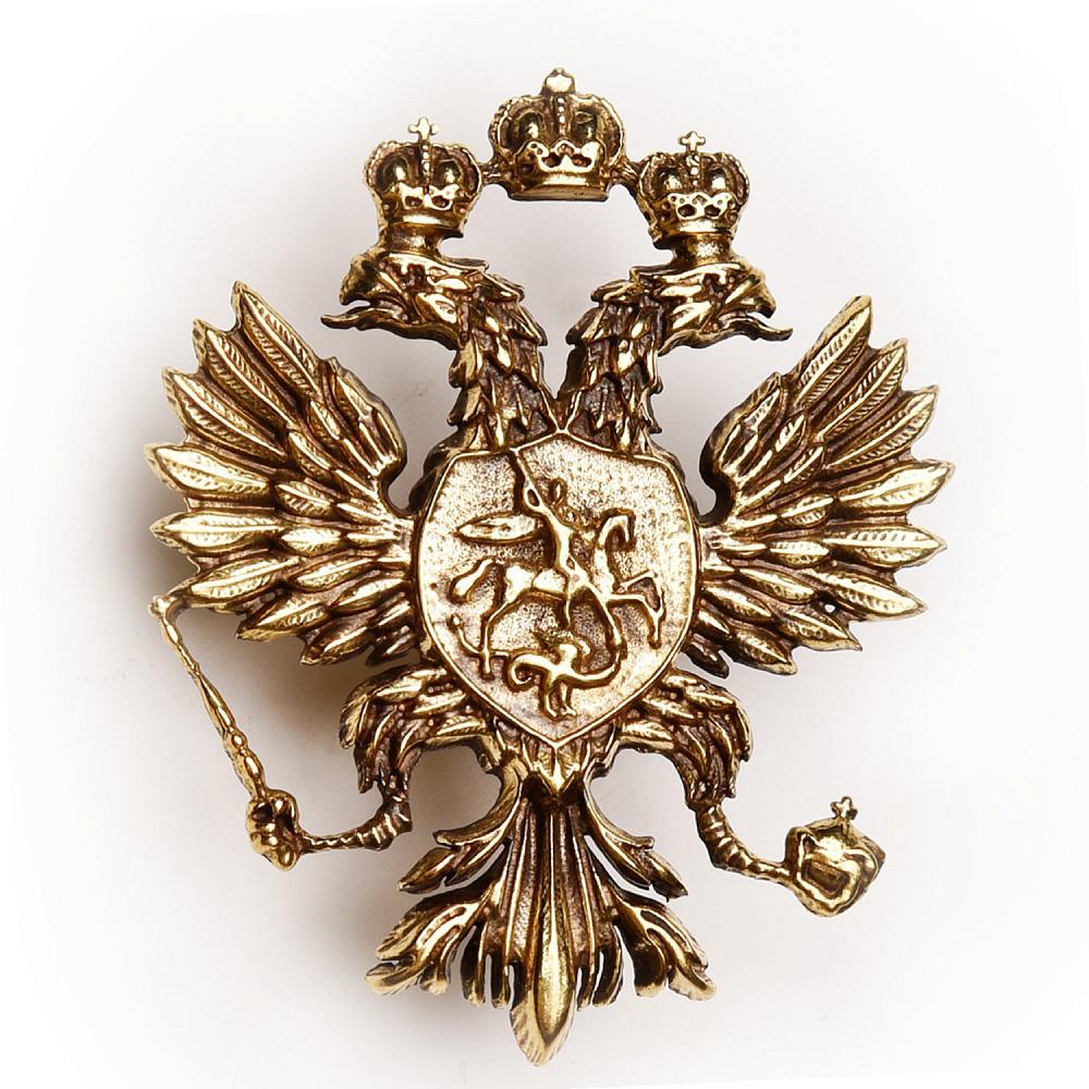 золотой значок герб